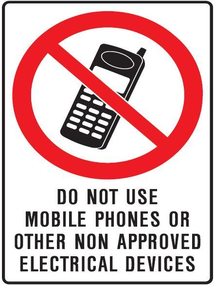 Why is the use of mobile phones at petrol stations prohibited?